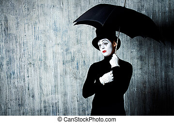mime - Portrait of a male mime artist standing under...