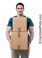 I got my parcels. - Smiling casual guy holding pile of boxes