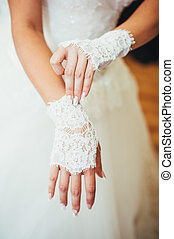 bride puts on wedding gloves - beauty bride puts on wedding...