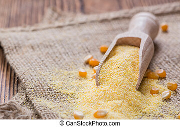 Cornmeal on rustic background - Portion of Cornmeal on...