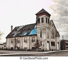 old church in ruins in poverty stricken section of a city