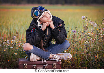 child dreaming of travel vacation or holidays