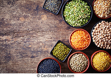 Legumes - Bowls of various legumes chickpeas, green peas,...
