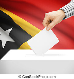 Ballot box with national flag on background - East Timor -...