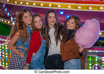 group of girls at carnival fair. - group of girls at...