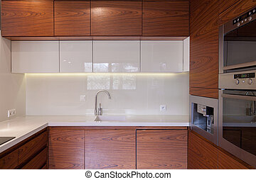 Wooden kitchen unit in traditional cozy interior