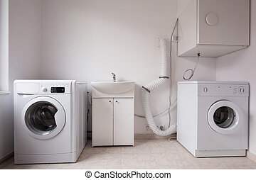 Automatic washing machines in laundry - Close-up of...