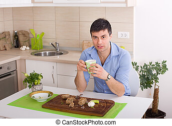 Man having snack - Young man drinking coffee after healthy...