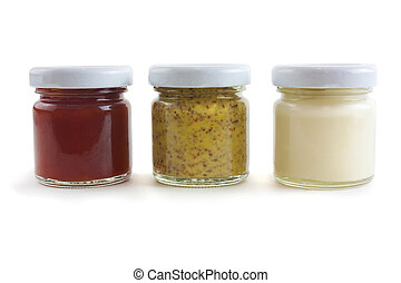 mustard, mayo and sauce - Jars of sauces including mustard,...