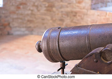 memories of old battles - detail of an old cannon inside a...