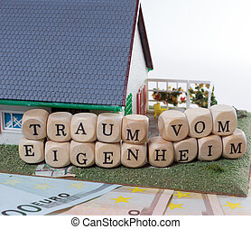 Home Ownership - Euro Banknotes with Wooden cubes and the...