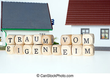 Home Ownership - Wooden cubes and the german words dream of...