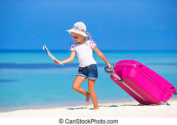 Little adorable girl with big suitcase on tropical white...