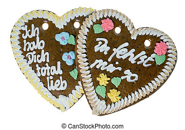 Love - two gingerbread hearts isolated over a white...