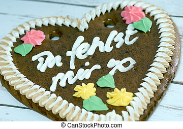 Love - gingerbread heart with the german words I miss you so
