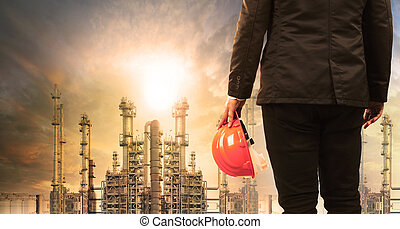 engineering man with safety helmet standing in industry...