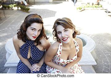 stylish retro Girls - Young beautiful caucasian women posing...
