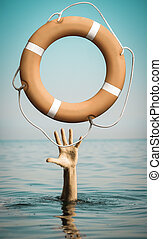 Hand in sea water with lifebuoy asking for help - Hand in...