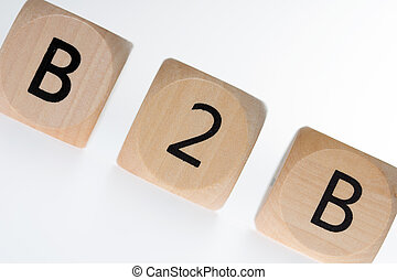 B2B - wooden dice with the abbreviation B2B