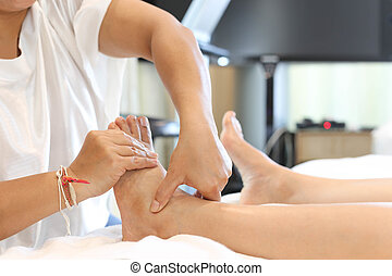 Woman receiving a foot massage - woman receiving and...