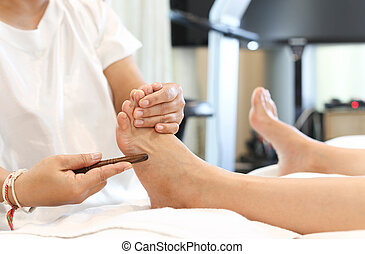 Woman receiving a Reflexology foot massage