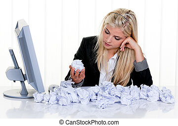 Woman Surrounded by Crumpled Paper - Attractive blonde woman...