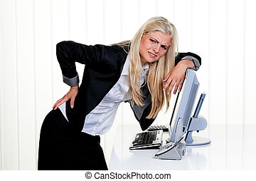 Frustrated Businesswoman Leaning on Computer Monitor -...