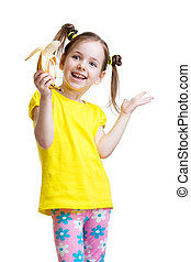 cute little girl eating banana isolated on white