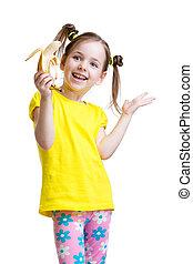 cute little girl eating banana isolated on white