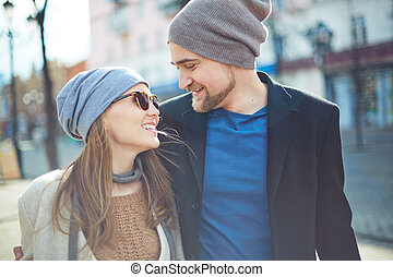Happy couple in stylish clothes dating outdoors