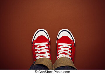 Feet From Above, Teenager in Sneakers Standing on Brown...