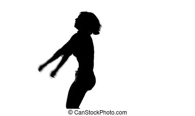 The black silhouette of a dancing girl on a white background
