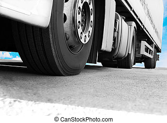 truck on road close-up - big white truck on road close-up