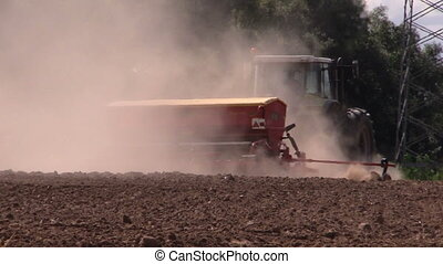 fertilize work field dust - Dust rising from tractor...