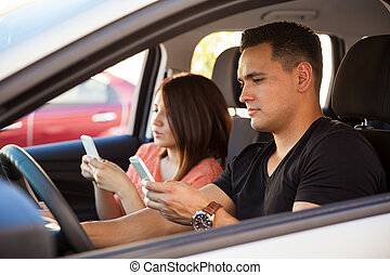 Young adults texting and driving - Portrait of reckless...
