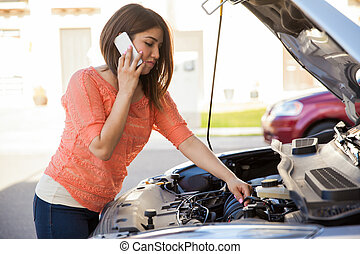 My car won't start - Pretty young brunette calling someone...