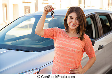 I just bought a car! - Beautiful young brunette showing off...