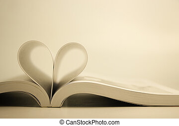 Opened book with heart page against blank background.