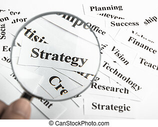 Strategy concept - Magnifying glass is focusing on the...