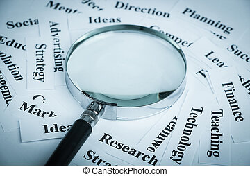 Business vision concept - Magnifying glass and lot of other...
