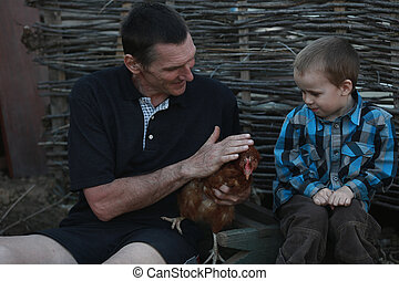 city boy first saw the chicken - grandfather to his grandson...