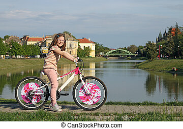 happy little girl with bicycle