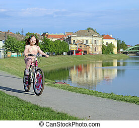 little girl riding a bicycle