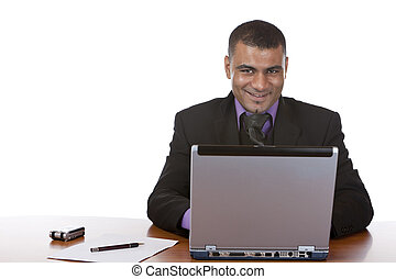 Business man sitting in office and works on laptop computer