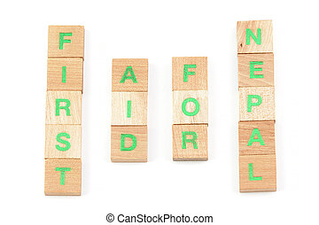 first aid for nepal written with scrabble letters