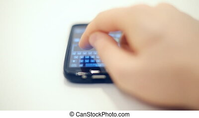 Man typing and sending sms.