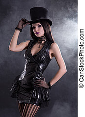 Cabaret girl in fetish dress and tophat - Cabaret girl in...