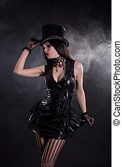 Sensual cabaret girl in fetish dress and tophat