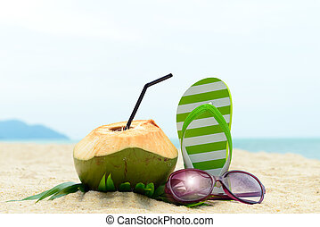 Summer beach - Pair of green striped sandal, sunglasses and...