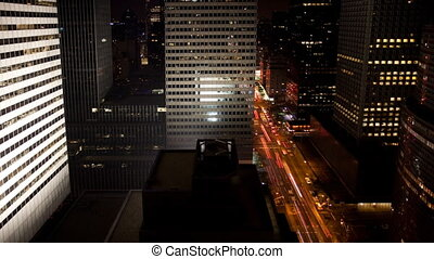 A stream of traffic in Manhattan - A stream of traffic at...